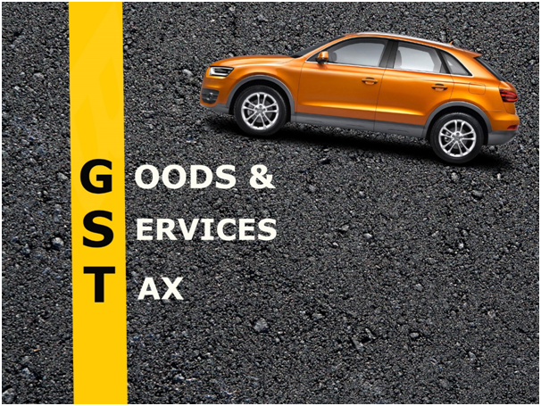 The Abbreviation Of GST With A Image Of Car In A Grey Background.